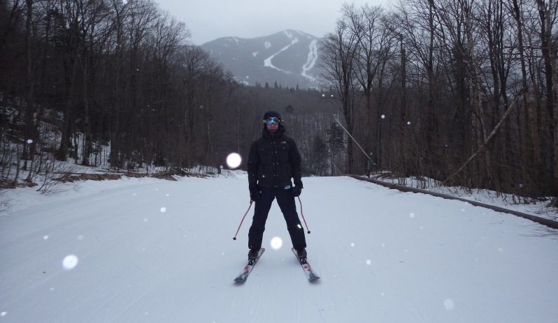 The man skiing from our hotel room to Smugglers Notch. In the background is Madonna mountain.